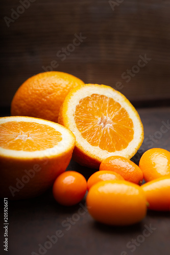 Close-up of oranges and cmquats on a dark background