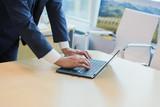 male office worker suit laptop window desk - 205944831