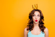 Leinwanddruck Bild - Portrait with copyspace empty place of funny stupid girl looking at crown on head with eyes sending kiss with pout lips isolated on yellow background advertisement concept