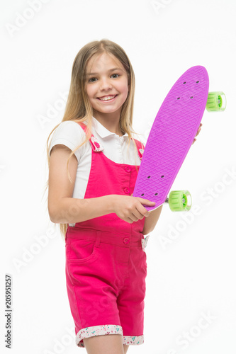 Plexiglas Skateboard Skateboard kid in pink jumpsuit. Small girl smile with skate board isolated on white. Child skater smiling with longboard. Sport activity and energy. Childhood and active games. Just relaxing.
