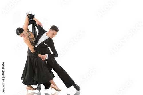 Fototapeta ballroom dance couple in a dance pose isolated on white