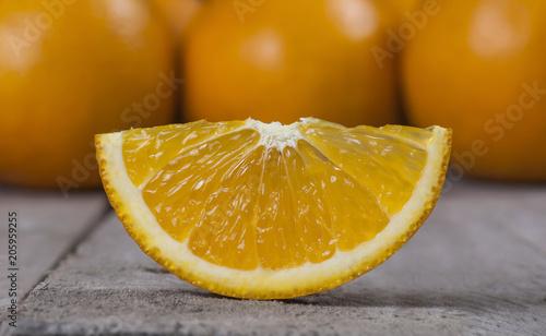 isolated juicy orange on wooden table