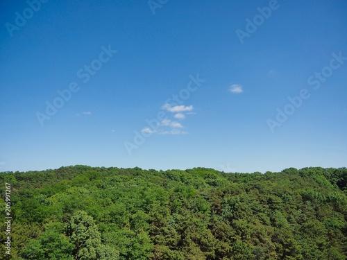 Fotobehang Blauwe jeans 한국 청주시의 산과 구름과 하늘