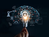 Hand holding light bulb and cog inside and innovation icon network connection on brain background, innovative technology in science and industrial concept - 205994497
