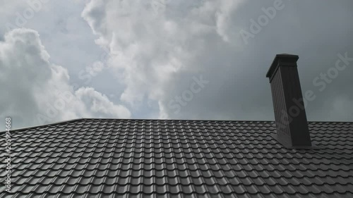 Roof of house and time lapse sky clouds motion.