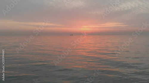Low flight over the sea surface. Beautiful reflection on waves water. Aerial 4k video. Seascape nature footage.