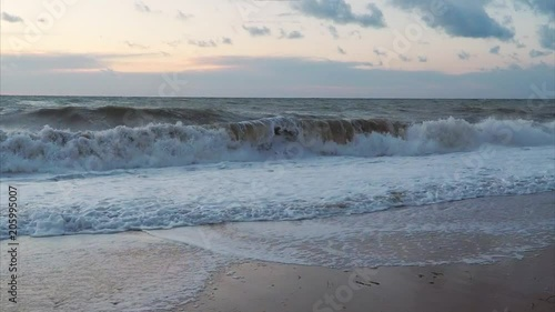 Wave splash slow motion. Stormy weather on sea. Natural scene.