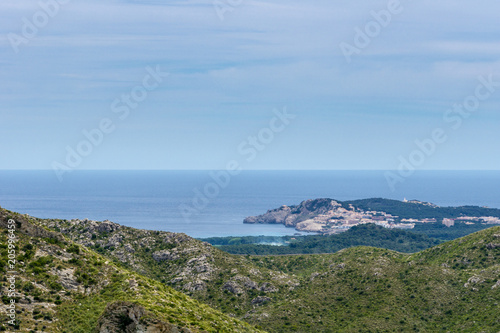 Mallorca, Aerial view on holiday island coast and village at sea with lighthouse from mountains