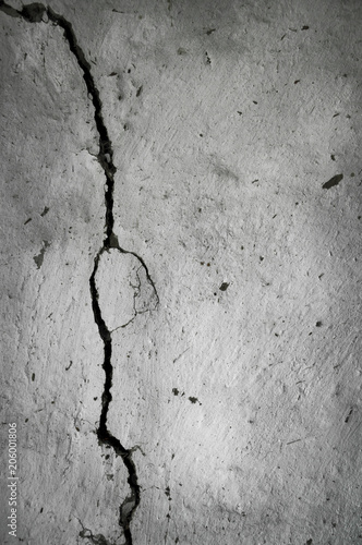 old plastered wall with a crack in it