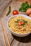 instant noodle in bowl cooked spicy taste topping with eggs - 206006276