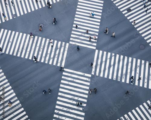 Leinwanddruck Bild People walking on Crossing city street  crosswalk top view
