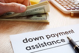 Down payment assistance form and dollar banknotes. - 206014416