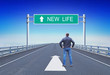 Quadro Man stands on a motorway in front of road sign with text New Life. Concept of movement to changes in future