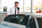 Successful mature businessman getting in taxi - 206020028