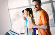 Leinwanddruck Bild - Picture of people running on treadmill in gym