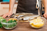 Woman will cook fish dish in kitchen. - 206026070