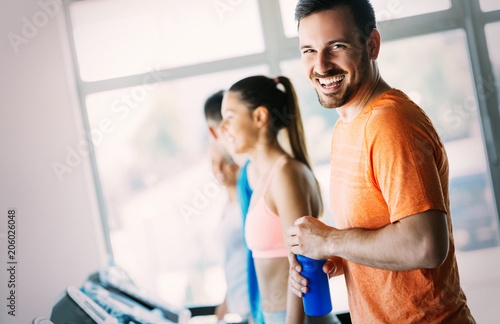 Leinwanddruck Bild Picture of people running on treadmill in gym
