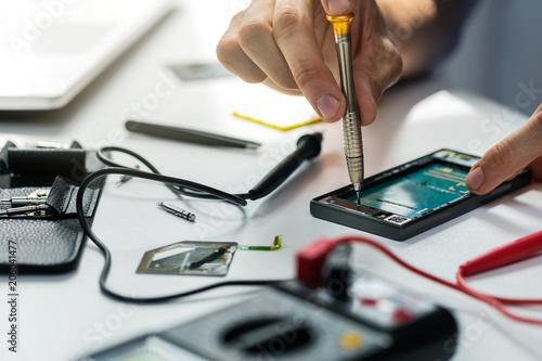 technician repairing broken phone
