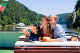 Happy family on river cruise looking at mountains from ship deck - 206043026