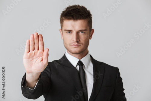 Portrait of a confident young businessman in suit