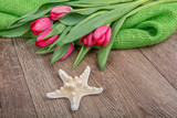 Concept of starfish and tulips on a table - 206045663