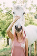 Woman with horse head. Funny horse image.