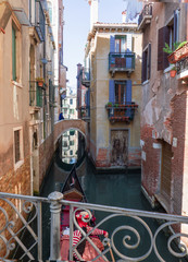 Venice, sightseeing in the canals aboard a Gondola.Italia