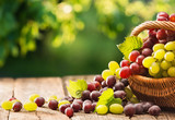 Grapes in a Basket on a Wooden Background. Harvesting