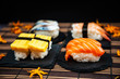 Quadro fresh sushi traditional japanese food on the table