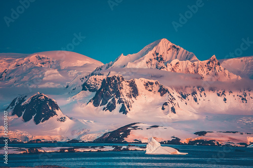 Fotobehang Antarctica The Antarctic peninsula mountain range that was shot during the extreme expedition to the Vernadsky Research Base. The beauty of snow-covered mountain crest and Pacific Ocean.