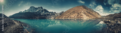 Spectacular scenery the crystal clear Gokyo Lake on the mighty snow-covered Himalayas background. Strength and beauty of wild virgin nature. Ideal image for the backgrounds and wallpapers.