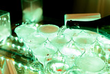 Champagne wine chrystal glasses set in night club bar at expensive luxury restaurant cocktail party wedding celebration - 206084872