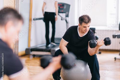 Sticker Older man workout at the gym