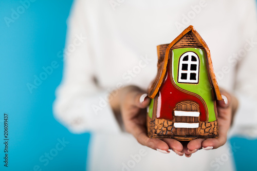 Female hands holding a toy house