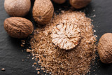 aromatic nutmeg on a dark stone background - 206101408