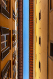 Top of the facades of narrow italian street against blue sky. Architectural abstract concept - 206111067