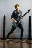 Young man playing electric guitar - 206120457