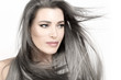 Young woman with long trendy silver hair. Care and hair products concept