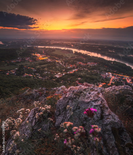 Fotobehang Grijze traf. View of Small City of Hainburg an der Donau with Danube River as Seen from Rocky Hundsheimer Hill at Beautiful Sunset