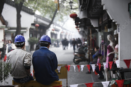 Fototapeta Chinese workers in the city 2