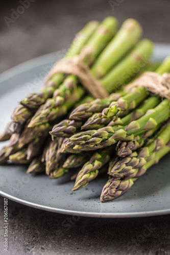 Close-up Bunch of fresh asparagus on plate