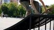 teen skateboarding in skate park