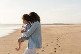 Mother at the beach with toddler