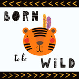 Hand drawn vector illustration of a cute funny tribal tiger with feathers, lettering quote Born to be wild. Isolated objects. Scandinavian style flat design. Concept for children print.