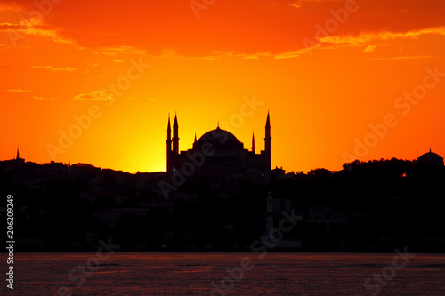 Fotobehang Oranje eclat Ramadan time with the muslim city istanbul silhouette