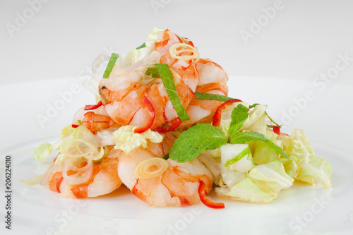 Fototapeta Large, beautiful shrimp with salad on a white plate.