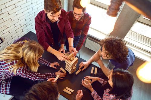 Top view friends play indoor board games.