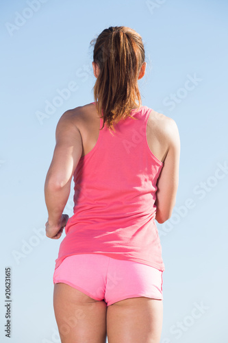 Fotobehang Hardlopen female jogging at sea beach