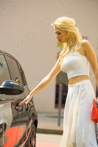Sticker Fashionable woman opening car