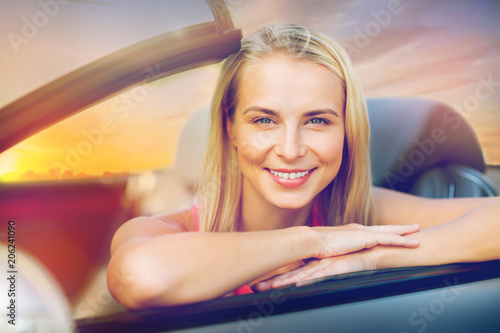 Sticker travel, road trip and people concept - happy young woman in convertible car